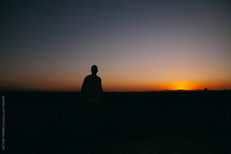 Silhouette of a Man at Sunset by VICTOR TORRES for Stocksy United