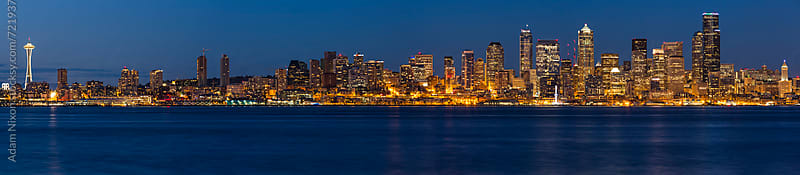 Seattle skyline at night, panoramic by Adam Nixon for Stocksy United