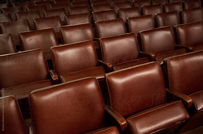 emoty brown leather theatre chairs by Sonja Lekovic for Stocksy United