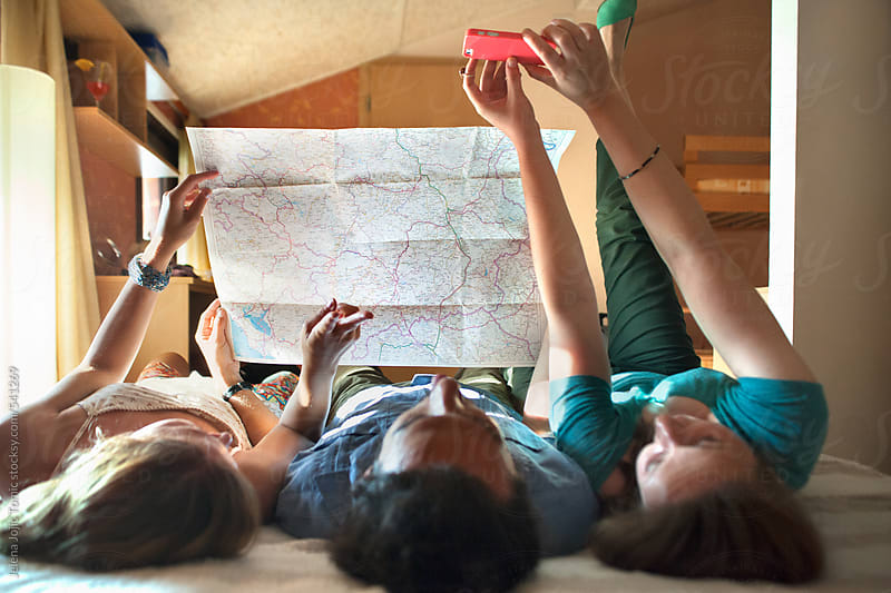 Friends backpackers are planing their trip by Jelena Jojic Tomic for Stocksy United