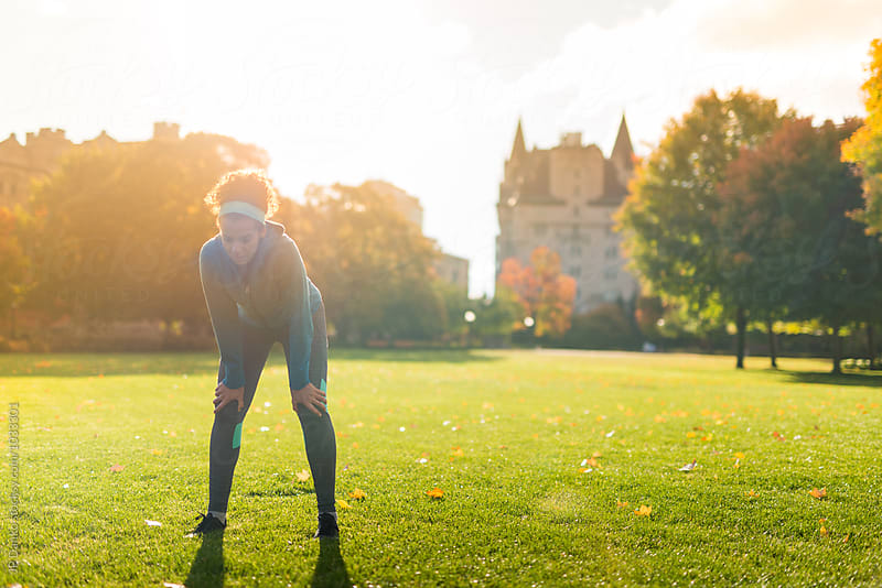 Young Woman Resting After Jogging In Ottawa Near Parliament Hill by JP Danko for Stocksy United