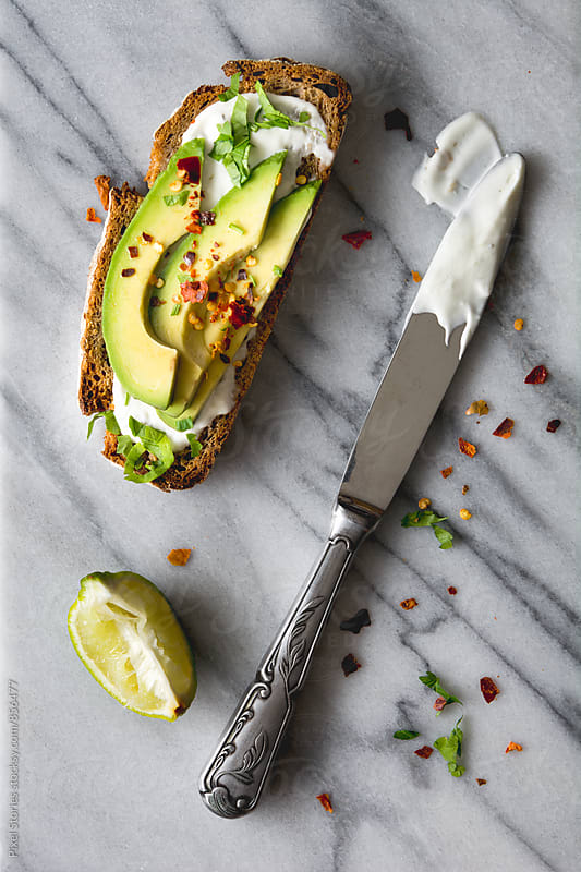 Avocado and sour cream toast by Pixel Stories for Stocksy United