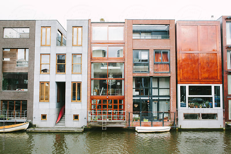 Unique, modern canal houses along a waterfront in Amsterdam by Ivo de Bruijn for Stocksy United