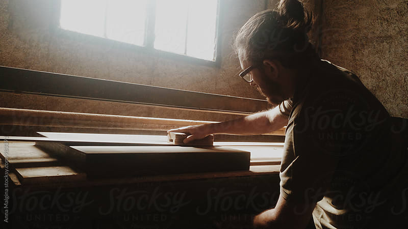 A carpenter working with a wood by Anna Malgina for Stocksy United