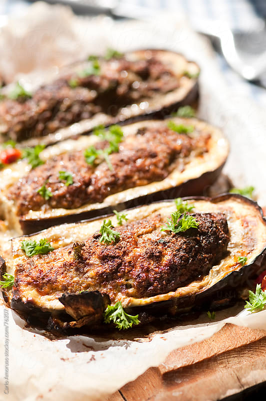 Eggplant filled with mince meat. by Carlo Amoruso for Stocksy United
