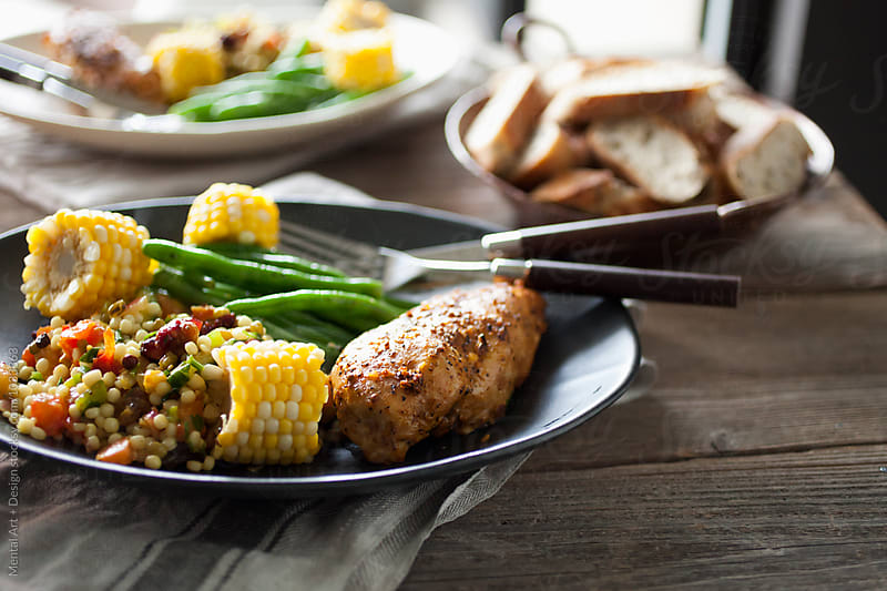 Oven Grilled Chicken Breast, Couscous, Corn cob and Green Bean Salad by Mental Art + Design for Stocksy United