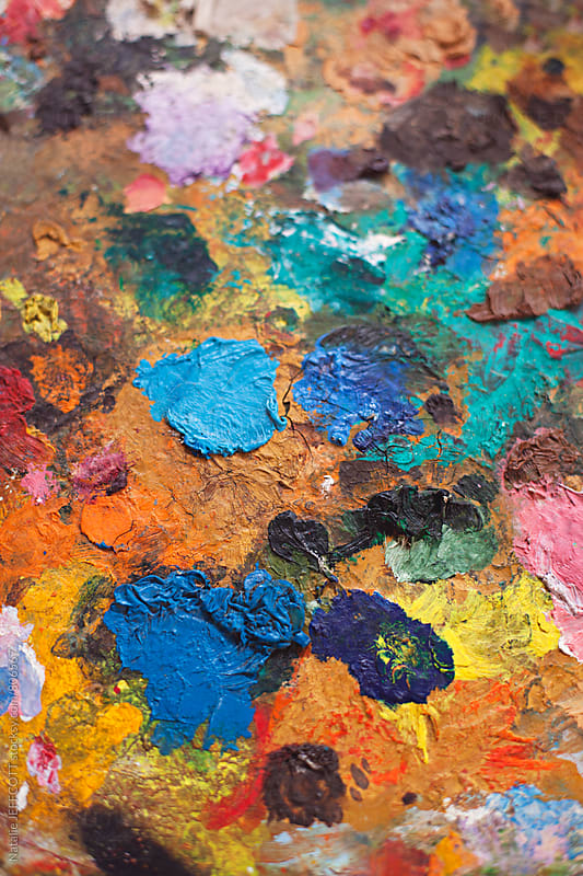 close up of artists oil paint palette by Natalie JEFFCOTT for Stocksy United