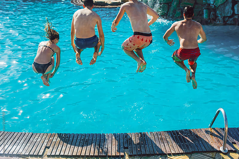 Friends Jumping in the Swimming Pool by Lumina for Stocksy United