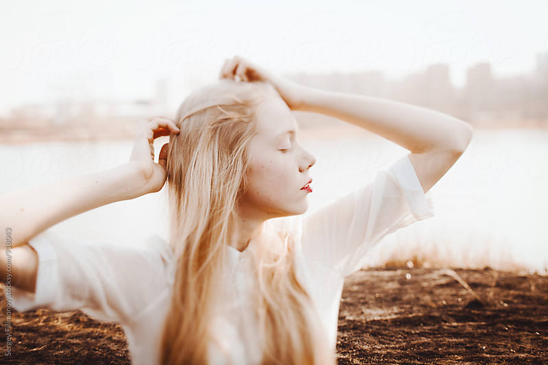 Young blond girl enjoying spring wind by Sergey Filimonov for Stocksy United