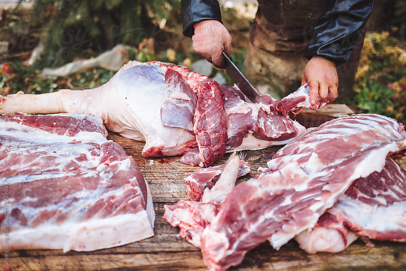 Cutting pork in a village of China by zheng long for Stocksy United