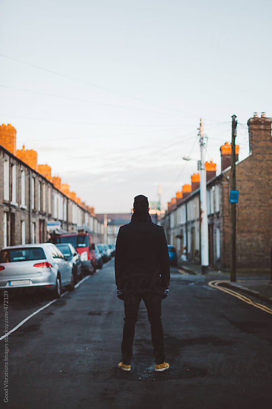 Man standing in the middle of the road by Good Vibrations Images for Stocksy United