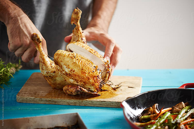 Preparing beer can chicken by Martí Sans for Stocksy United