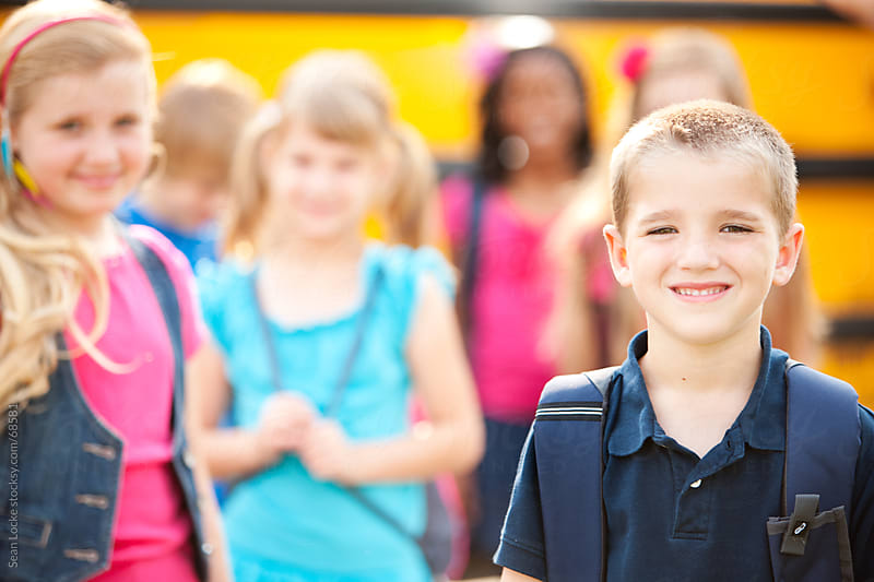 School Bus: Focus on Cheerful Smiling Kid by Sean Locke for Stocksy United