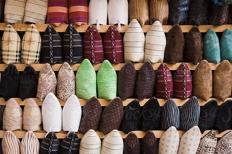 Slippers in a Fez market by Jon Rodriguez for Stocksy United