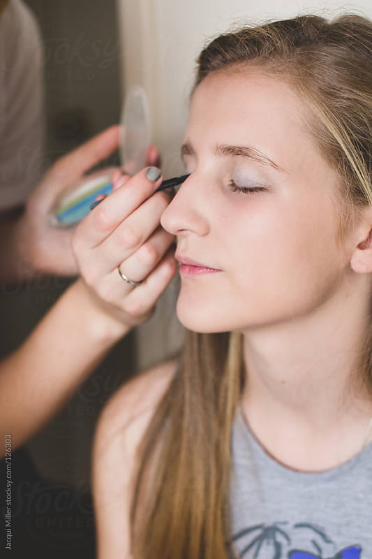 Young girl getting ready for a night out by Jacqui Miller for Stocksy United