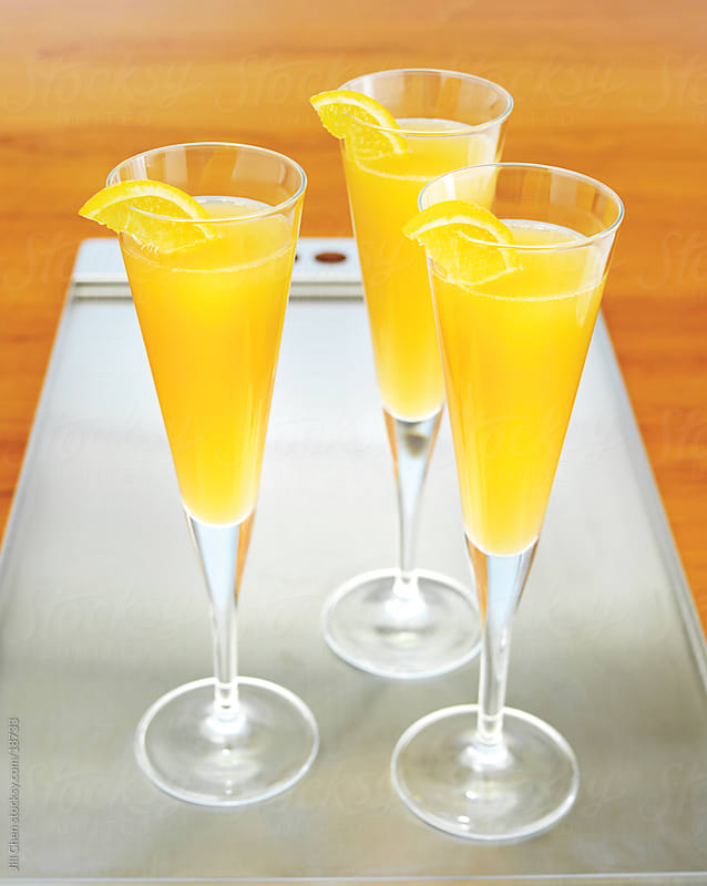 Champagne and Orange Juice by Jill Chen for Stocksy United