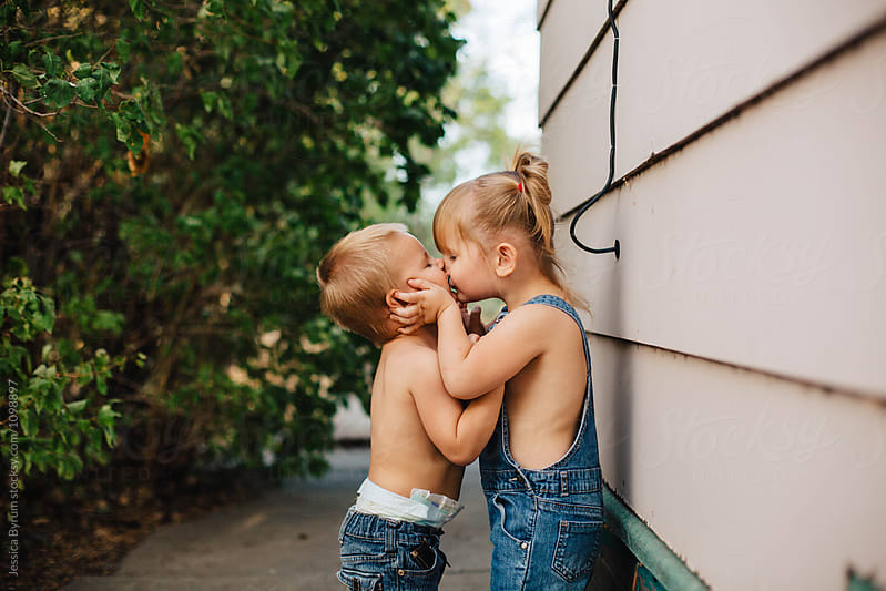 Sibling Kisses by Jessica Byrum for Stocksy United