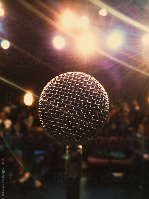Microphone with Lights and Crowd by B. Harvey for Stocksy United