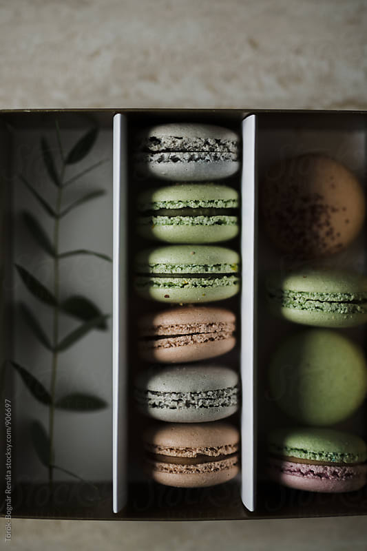 Overhead of macarons in a box by Török-Bognár Renáta for Stocksy United