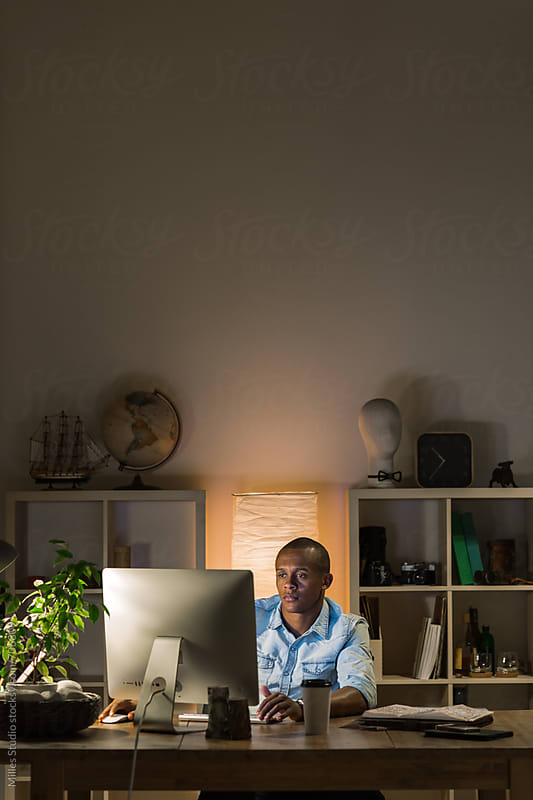 Man working at night by Milles Studio for Stocksy United