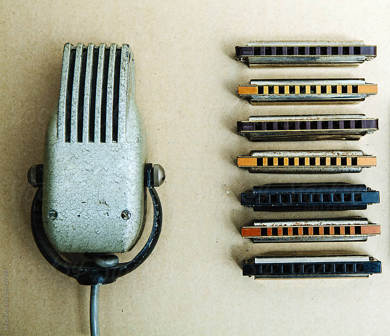 Vintage microphone and blues harmonicas . by kkgas for Stocksy United