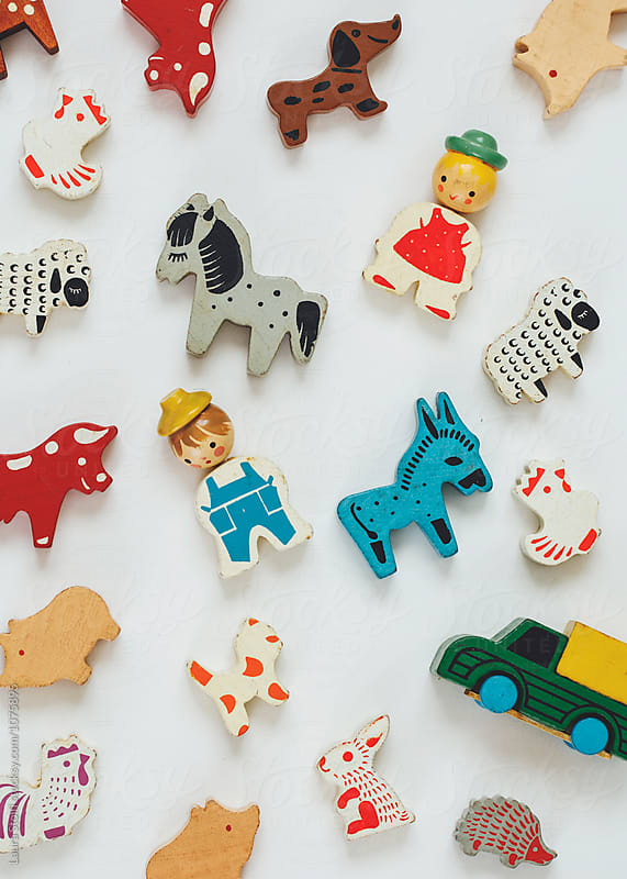 The farm: old fashioned wooden toys in the shape of farm animals and people seen from above by Laura Stolfi for Stocksy United