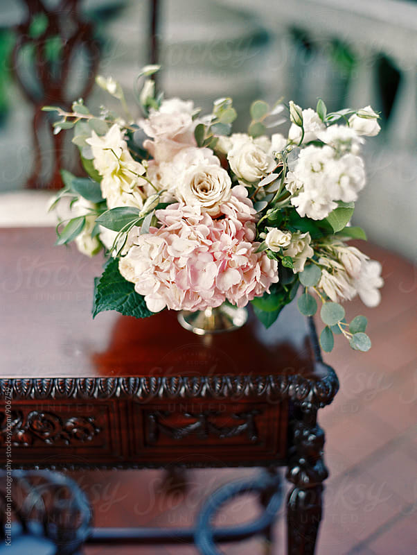 flowers on antique table by Kirill Bordon photography for Stocksy United