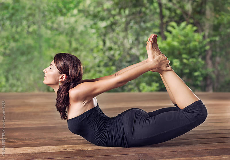Yoga: Woman Doing Bow Pose by Julien L. Balmer for Stocksy United