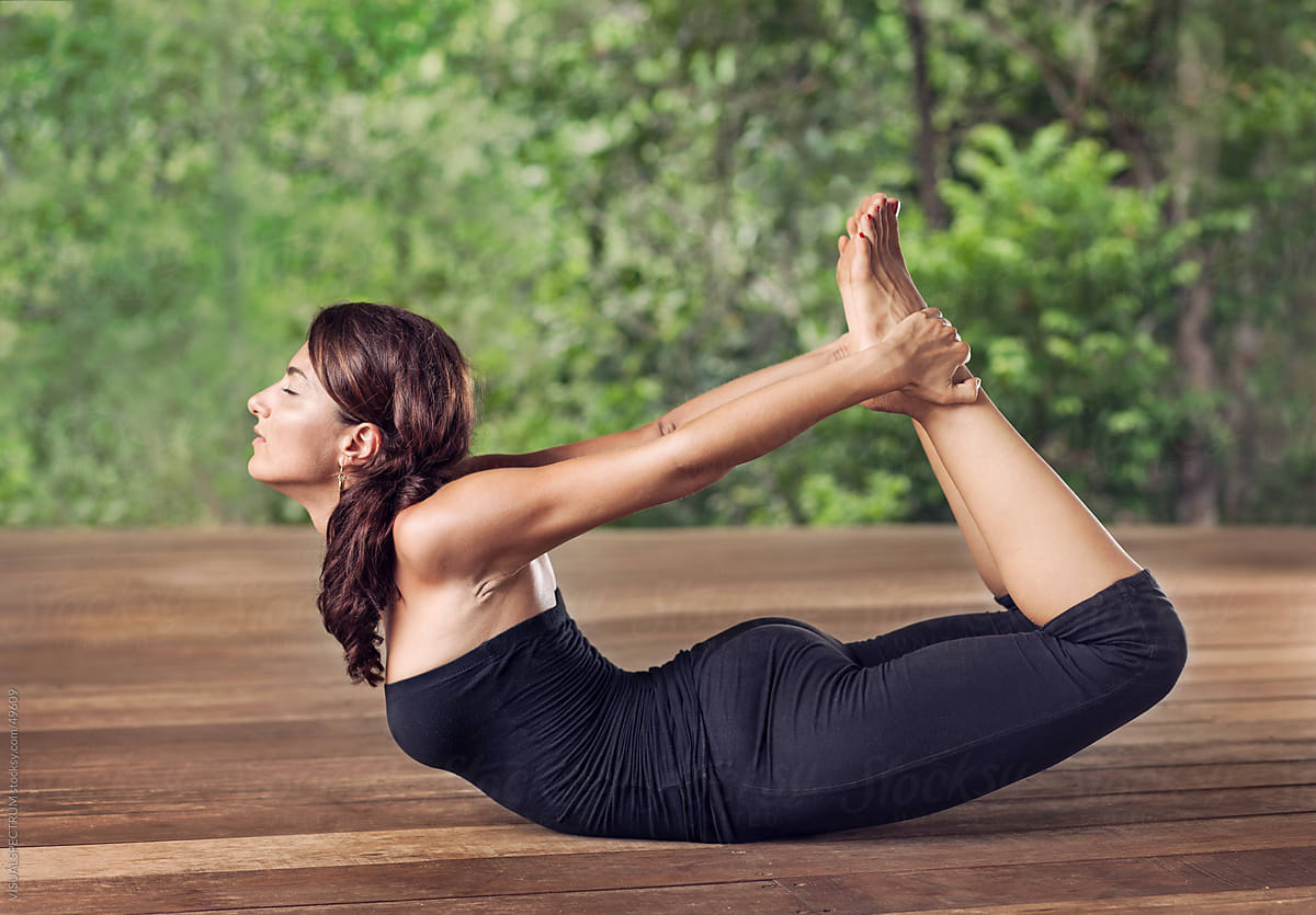 Yoga: Woman Doing Bow Pose by VISUALSPECTRUM - Stocksy United