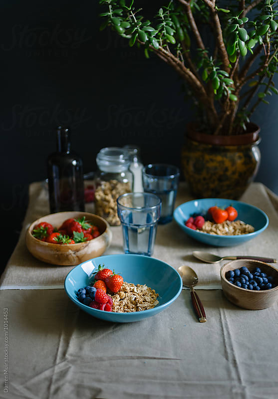 Breakfast: Breakfast table with granola and fruit. by Darren Muir for Stocksy United