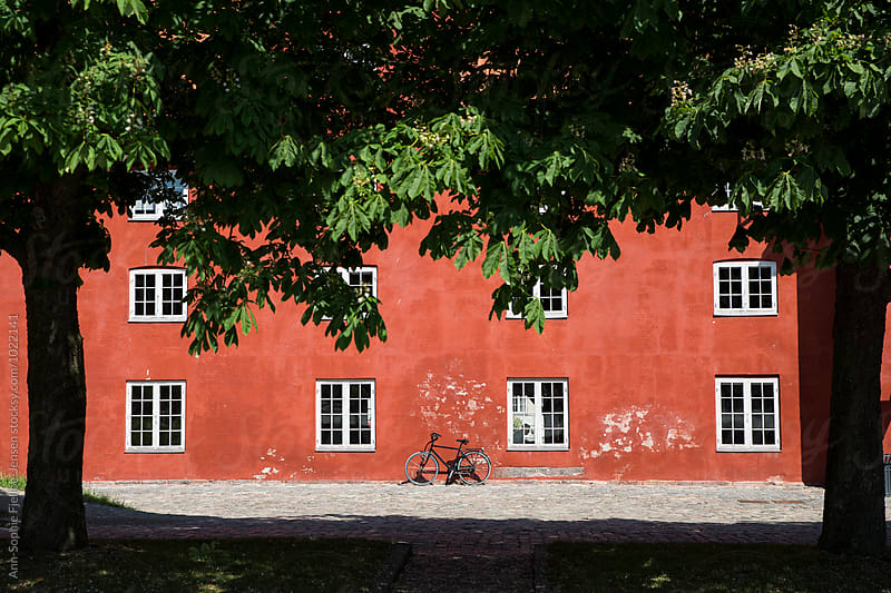 A bike leaning on a wall by Ann-Sophie Fjelloe-Jensen for Stocksy United