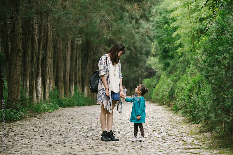 Young mother and toddler girl walking in a park by Maa Hoo for Stocksy United