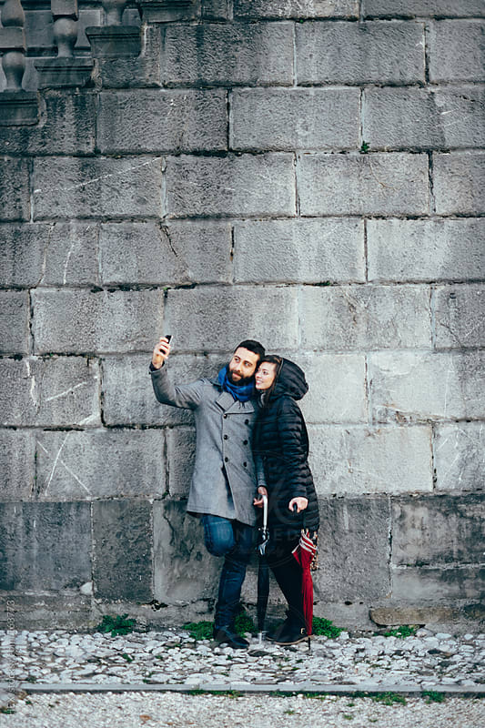 Young Couple Taking Picture With Mobile Phone by HEX. for Stocksy United
