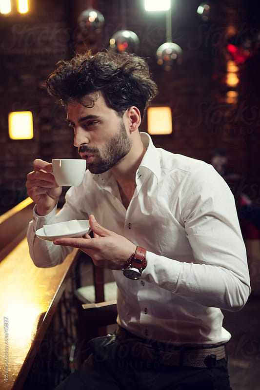 Handsome young man drinking coffee. by Mosuno for Stocksy United