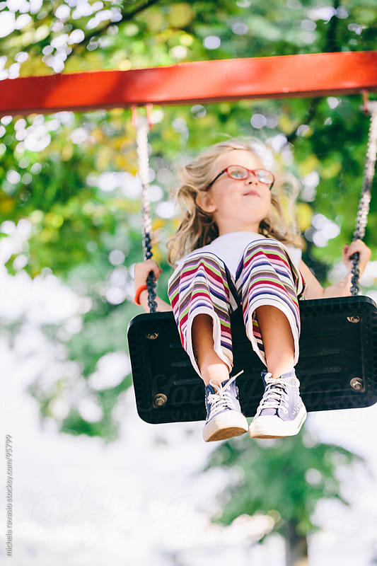 Little girl on a swing by michela ravasio for Stocksy United