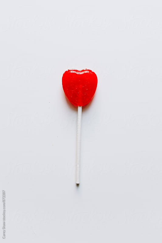 Valentine's heart candy lollipop by Carey Shaw for Stocksy United