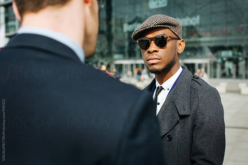 Stylish Young Black Businessman Meeting With Caucasian Businessman on Sunny Day by Julien L. Balmer for Stocksy United