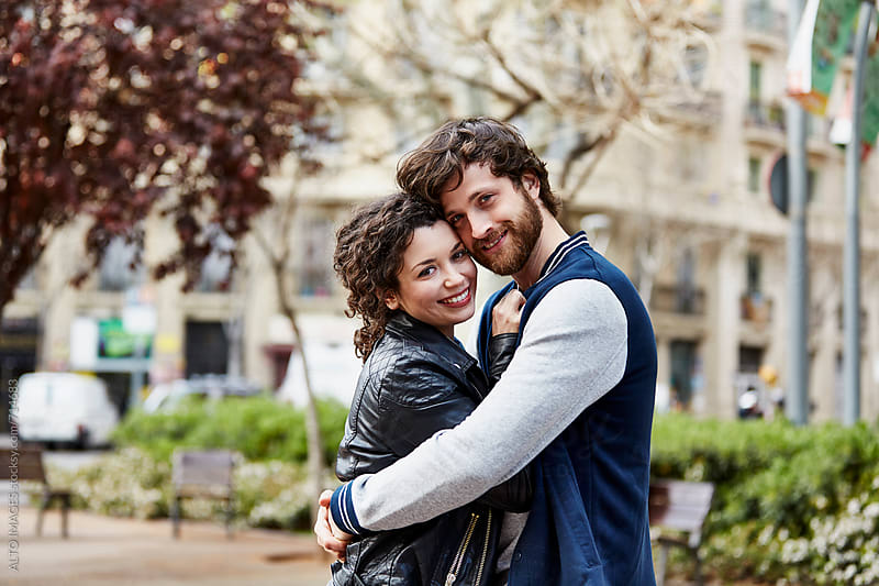 Romantic Young Couple Embracing In City by ALTO IMAGES for Stocksy United