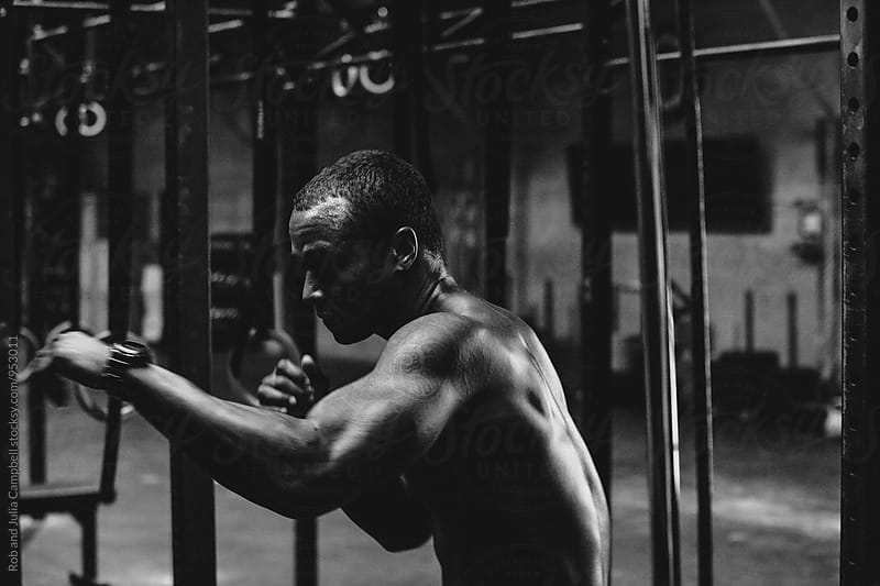 Young, fit black man training hard in fitness gym - boxing by Rob and Julia Campbell for Stocksy United