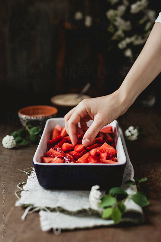 Making strawberry crumble by Tatjana Ristanic for Stocksy United