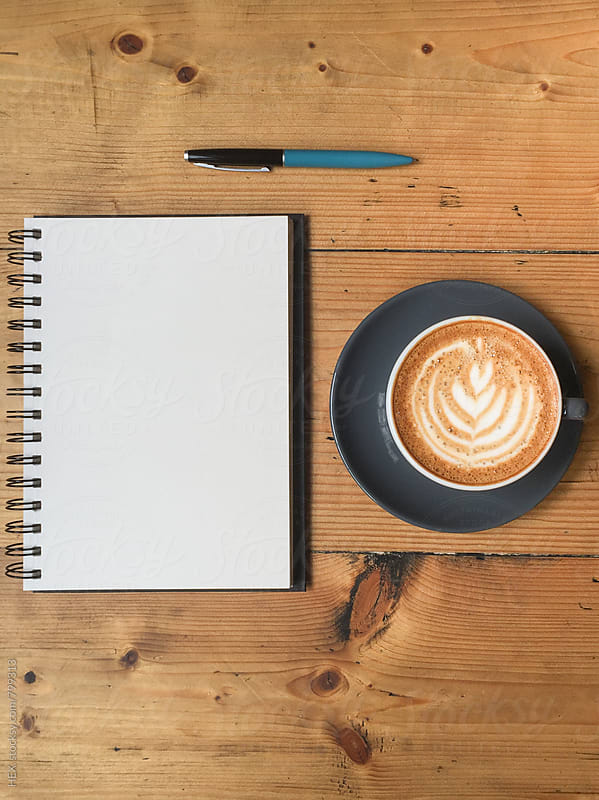Cappuccino and Note Book with Pen on the Wooden Table by HEX. for Stocksy United