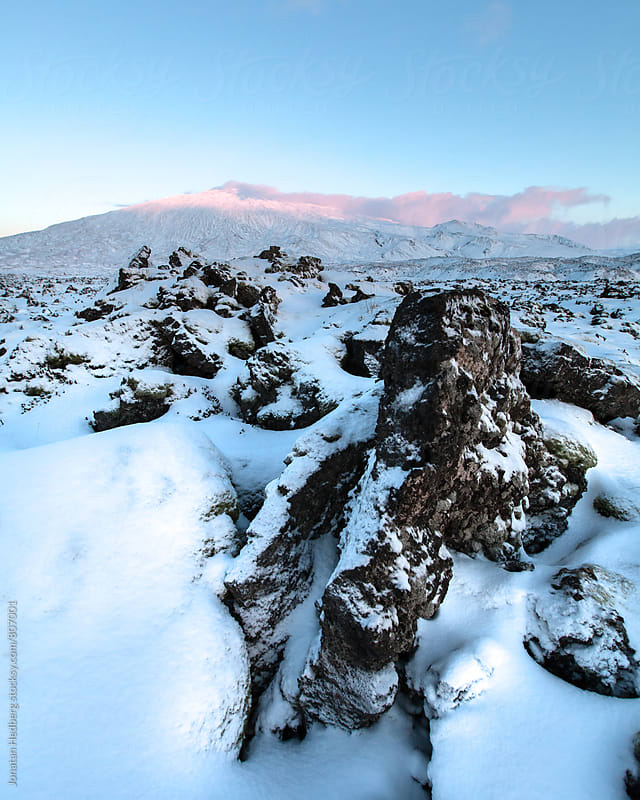 A snow covered lava field by Jonatan Hedberg for Stocksy United