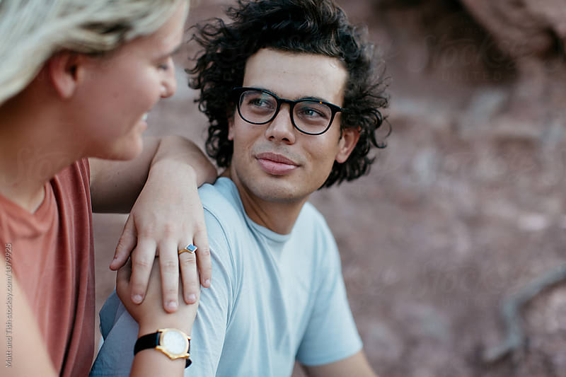 Young couple on red mountain by Matt and Tish for Stocksy United
