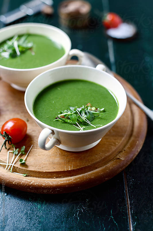 Spinach soup garnished with micro greens. by Darren Muir for Stocksy United