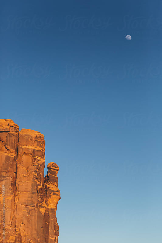 The rock and the moon in Monument Valley by michela ravasio for Stocksy United