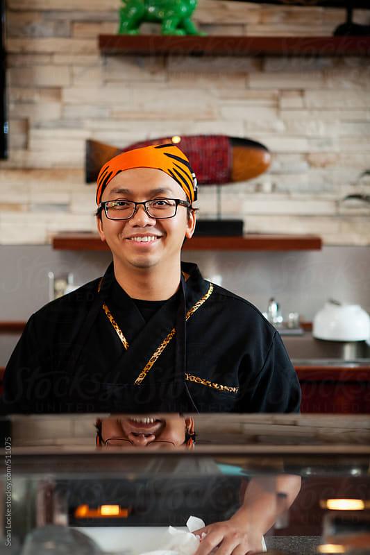 Sushi: Cheerful Sushi Bar Chef by Sean Locke for Stocksy United