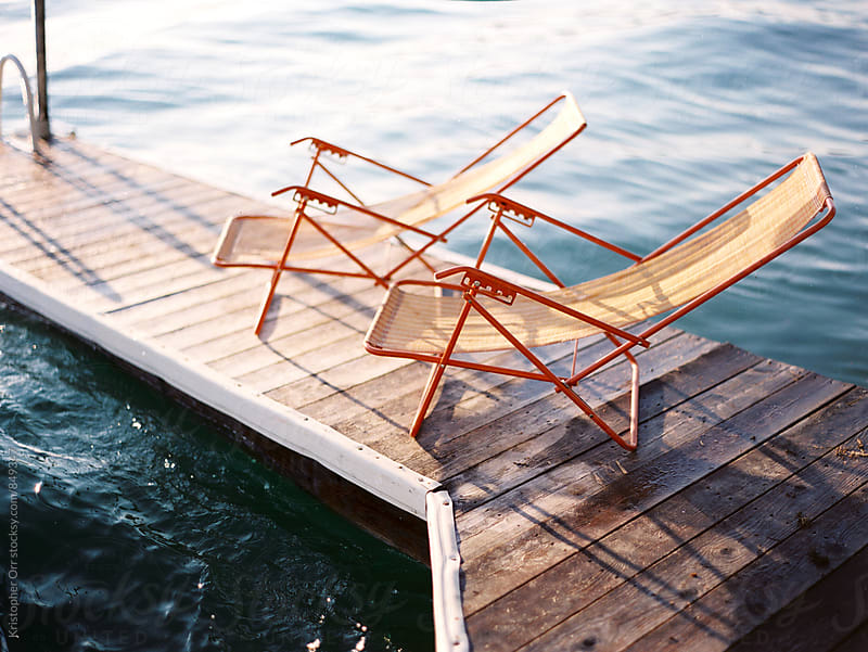 Beach Chairs on a Dock by Kristopher Orr for Stocksy United