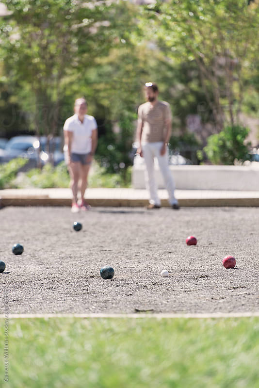 Friends Practicing Bocce Ball by Cameron Whitman for Stocksy United