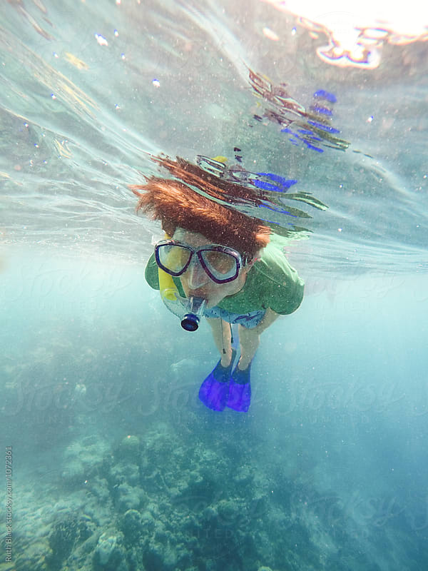 Boy snorkelling underwater by Ruth Black for Stocksy United