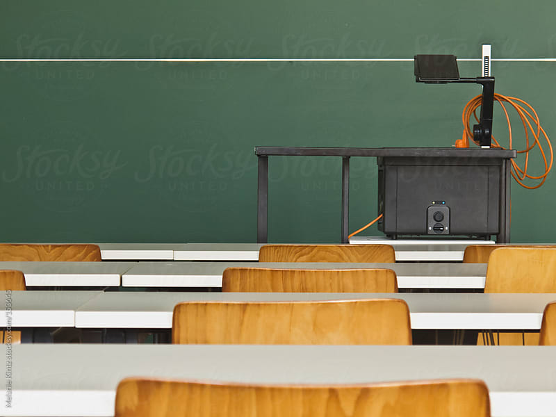 Empty classroom with overhead projector by Melanie Kintz for Stocksy United